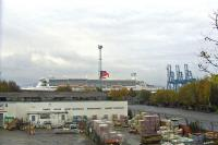 Looking over the site of Princes Pier on 19th October 2009 with the buildings in the foreground standing on the site of the former shed. In the background is the Queen Mary 2, calling at Greenock Ocean Terminal as part of her 5th Birthday celebrations. The visit continues a long tradition of ships calling at Greenock Ocean Terminal and, prior to that, Princes Pier, which occupied the site until 1966.  <br><br>[Graham Morgan&nbsp;19/10/2009]