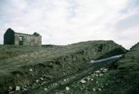 By 1968 the winding house at the top of the Ingleby Incline (65 chains at 1 in 5 and 1 in 6) on the Rosedale railway had gone. The line closed in 1928 and the final locomotive lowered down the incline in 1929. The line served ironstone mines.<br><br>[John Thorn&nbsp;/03/1968]