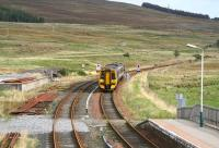 The 1101 service from Inverness to Kyle of Lochalsh drifts into Achnasheen station on 1 October 2009.<br><br>[John Furnevel&nbsp;01/10/2009]