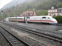 An ICE from Berlin arrives at a very wet Interlaken Ost on 12 October 2009. The track in the foreground is the narrow gauge line from Brienz/Luzern.<br><br>[Michael Gibb&nbsp;12/10/2009]