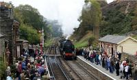 A southbound service enters Goathland station having worked hard on the climb from Grosmont during the North York Moors Railway's 'War Weekend' on 18 October 2009. Windows at the station have had tape applied and many of the people on the platform are wearing 1940s style clothing including military uniforms.<br><br>[John McIntyre&nbsp;18/10/2009]