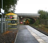 The short platform at Beauly on 3 October looking towards Muir of Ord. A non-stop 158 service running north through the station at speed stirs up some of the autumn leaves lying below the bridge. <br><br>[John Furnevel&nbsp;03/10/2009]