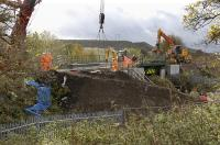The main line through Inverkeithing has been closed over the weekend of 24/25 October.� A minor bridge giving access to a cemetery to the south of the town has been replaced and track is seen here being reinstated on Sunday 25th.<br> <br><br>[Bill Roberton&nbsp;25/10/2009]
