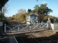 The signal box at Fiskerton station leans noticeably backwards. As can be seen here the new access steps are level but the box has a definite tilt. However, it still contains a lever frame controlling the semaphores protecting the crossing and the block section. The gates however are opened manually. View towards Nottingham. <br><br>[Mark Bartlett&nbsp;25/10/2009]