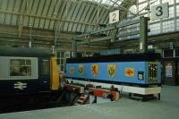 The imaginatively decorated platform terminus at Helensburgh Central as recorded on February 9th 1985. The poster on the right hand end of the blue cladding warns that playing 'Station Invaders' is a potentially fatal game. Since then, both the Class 303 units and computer games have moved on��<br><br>[Mark Dufton&nbsp;09/02/1985]