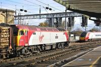 Virgin <I>Thunderbird</I> no 57310 <I>Kyrano</I> with the Kingmoor - Chirk timber train is overtaken by a southbound Pendolino in Carlisle station on 26 October.<br> <br><br>[Bill Roberton&nbsp;26/10/2009]