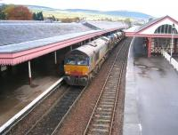 Back end of an RHT train heading north through Aviemore on 8 October 2009 with DRS 66413 bringing up the rear.<br><br>[Bruce McCartney&nbsp;08/10/2009]