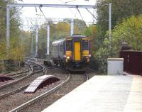 Northbound 156456 approaches the now fenced off wooden southern end to the platforms at Coatbridge Central with a service for Cumbernauld on 28 October 2009.<br><br>[David Panton&nbsp;28/10/2009]