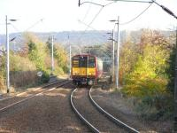 314 202 approaches the (clearly) island platform at Langside with an Outer Circle working on 28 October 2009.<br><br>[David Panton&nbsp;28/10/2009]