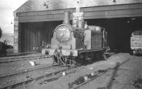 McIntosh 2P no 55185 stands at Keith shed in March 1959. The locomotive was withdrawn by BR in July 1961 following official closure of the shed to steam the previous month. 61C continued to be used as a diesel depot until the mid 1970s. The site later became a Chivas Brothers whisky bond, with the north wall of the old shed being incorporated into one of the new buildings [see image 5347].<br><br>[Robin Barbour Collection (Courtesy Bruce McCartney)&nbsp;25/03/1959]