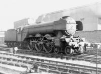 A3 Pacific no 60070 <I>Gladiateur</I> approaching 52B Heaton Shed in 1964, passing one of many engineering works still active in this part of the city at that time. [See image 25886]<br><br>[David Pesterfield&nbsp;05/04/1964]