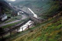 A Sheffield-bound train passes the closed Woodhead station at the  western end of Woodhead Tunnel in September 1966.<br><br>[John Thorn&nbsp;/09/1966]