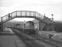 The 10.10 Speyside freight trip from Aviemore trundles through Grantown-on-Spey East on 11 April 1968. The original train loco had failed and this replacement had been sent all the way from Perth. Following the withdrawal of passenger services in 1965, Grantown was the first block post and crossing loop east of Aviemore, but with one train a day in each direction any such crossing must have been an unusual event. [See image 38990]<br> <br><br>[David Spaven&nbsp;11/04/1968]