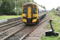 View south from Dingwall station as the 1101 Inverness - Dingwall service runs slowly towards its destination on 1 October 2009. <br><br>[John Furnevel&nbsp;01/10/2009]