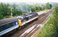 37404 <I>Ben Cruachan</I> leaves Dingwall on 12 May 1993 with the 1914hrs train to Kyle of Lochalsh.<br><br>[Ken Browne&nbsp;12/05/1993]