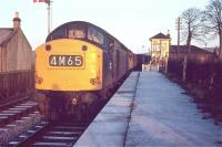 An EE type 4 with a freight, (carrying members of Edinburgh University Railway Society) at Heriot station in December 1968. What appears to be a white circle on the front of the locomotive is in fact a bung, inserted into the hole which had been bored to accommodate a cable for communication with the loco crew on the occasion of a previous Royal Train assignment.<br><br>[Bruce McCartney&nbsp;/12/1968]