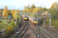 A pair of 320s passing at Sunnyside Junction, just to the west of Coatbridge Sunnyside station, on 28 October 2009. The line south to Whifflet Junction can be seen turning off bottom left here, while in the centre right, hidden behind the trains, is the remains of the junction that latterly served Gunnie Yard and Gartsherrie Cement Works to the north. In the centre left of the picture is part of the Summerlee Industrial museum site.<br><br>[David Panton&nbsp;28/10/2009]