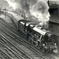 Stanier Black 5 no 45468, immaculately turned out by St Rollox shed, takes the <I>'Fife Coast Express'</I> out of Buchanan Street in 1959 at the commencement of its cross-country journey to St Andrews [see image 34385]. Even the signalman seems impressed.<br> <br><br>[Gordon Smith Collection (Courtesy Ken Browne)&nbsp;//1959]