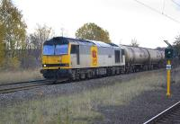 60091 <I>An Teallach</I> passes Gateshead Stadium metro station with the 6D43 Jarrow - Lindsey empty bogie tanks on 7 November.� Most of this class is currently stored out of traffic.<br> <br><br>[Bill Roberton&nbsp;07/11/2009]
