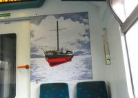 One of the picture panels carried by Class 320s since delivery in 1989.� Henry Bell's <I>Comet</I> of 1812 was not the world's first paddle steam vessel but is reckoned to be the first commercial one in Europe.� It was built in Port Glasgow and operated on the Clyde.� In order to show the paddles the artist has opted to depict the vessel clear of the water, with the part that would normally be below the waterline coloured red.� However, together with the background, this does give it the slightly disturbing (or <I>bad trip</I>) appearance of hovering above the water. <br> <br><br>[David Panton&nbsp;28/10/2009]