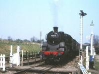 75014 departing Quorn & Woodhouse station on the Great Central Railway on 4 April 2002.<br> <br><br>[Peter Todd&nbsp;04/04/2002]