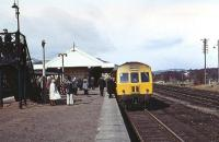 The Speyside Express railtour from Edinburgh to Boat of Garten on 07 April 1973 is seen on the outer face of the island platform at Aviemore whilst operating one of the three return trips to Boat of Garten. While today's trains on the Strathspey Railway operate from this platform, at that time the DMU had to first run into the headshunt at the south end of the station in order to access the original route north to Inverness via the line to the right of the train.<br><br>[John McIntyre&nbsp;07/04/1973]
