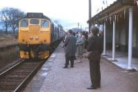 The official re-opening train (the normal mid-morning Inverness-Wick service) pulls into Alness station in May 1973. The man with the camera is Adrian Varwell, local representative of the Scottish Association for Public Transport, who played a big part in the re-opening campaign.<br> <br><br>[David Spaven&nbsp;07/05/1973]