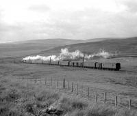 A Stanier Black 5 with a northbound parcels train photographed shortly after passing Beattock summit in the 1960s.<br><br>[A Snapper (Courtesy Bruce McCartney) //]