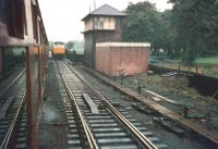 Photograph taken from a northbound Waverley route service shortly after leaving Carlisle in December 1968. The train is approaching Carlisle number 3 box after which it will cross the River Caldew before turning west at  Port Carlisle Junction. The train is about to pass a southbound WCML service which is slowing for the stop at Carlisle. [See image 26316]<br> <br><br>[Bruce McCartney&nbsp;/12/1968]