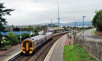 A service from the north pauses at Invergordon. The removal of the footbridge from Invergordon station has created quite a long walk for law abiding passengers who need to cross the tracks. And we have lost a vantage point for photographs.<br><br>[Ewan Crawford&nbsp;29/09/2009]