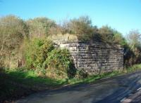Passenger services from Ormskirk to Rainford ceased in 1958 but the intermediate halt at Westhead, next to this overbridge, closed earlier in 1951. Although the long embankment to the west of this point is still there the overbridge has gone as has the eastern abutment, cleared to create a driveway to a house built on the old formation. Around Skelmersdale the trackbed is built over but at the Ormskirk end of the line cuttings, bridges and embankments can still be seen. Map Reference SD 439080. <br><br>[Mark Bartlett&nbsp;09/11/2009]