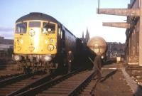 Shunting the Distillers Company sidings at Haymarket on an Edinburgh University Railway Society brake van trip in early 1973. Haymarket East Junction is in the background and the spires of St Mary's Cathedral stand on the skyline.<br> <br><br>[David Spaven&nbsp;//1973]