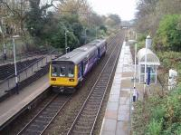 An East Lancashire line stopping service calls at Pleasington on its way to Preston and Blackpool South. Northern Pacers, such as 142054 seen here, still predominate on these services. This view looks west towards Hoghton.<br><br>[Mark Bartlett&nbsp;13/11/2009]