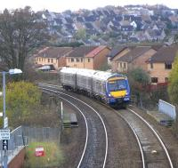 As can be seen from this picture Dunfermline is a hilly town, and <br> there's a sharp climb from Dunfermline Town station to Townhill <br> Junction, a few hundred yards behind the camera.� The old Class 117 DMUs, finally replaced 10 years ago this month, seemed to make particularly heavy weather of this grade, and there was a sigh of relief in the carriage when Townhill Junction was reached and everything stopped vibrating.� Making less of a fuss here on Sunday 15 November is 170 416 with an Outer Circle working about to Call at Queen Margaret. <br> <br><br>[David Panton&nbsp;15/11/2009]