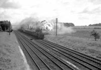 S15 30499 passes Winchfield, Hampshire, in 1960 with a westbound freight.<br><br>[John Thorn&nbsp;//1960]