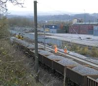 Ballast train alongside the WHM freight depot at Elderslie during track replacement and upgrading work on 15 November. New track to the right is already in place and awaiting the attention of the tamper.  <br><br>[Graham Morgan&nbsp;15/11/2009]
