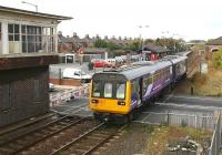 The 1003 Bishop Auckland - Saltburn leaves Redcar Central on 13 October and runs over West Dyke Road level crossing.<br><br>[John Furnevel&nbsp;13/10/2009]