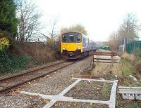 A Clitheroe to Manchester service, with 150149, draws past the now defunct sand drag at the foot of the gradient from Ramsgreave. The train runs over the short single line section through closed Daisyfield station to join the East Lancashire line at Daisyfield Junction. The old sand drag, which stems from the days when unfitted freights were diverted away from the electrified WCML to run via the Settle and Carlisle, is piled high with concrete sleepers in readiness for Sunday engineering work.<br><br>[Mark Bartlett&nbsp;17/11/2009]