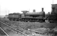 Caley <I>Jumbo</I> 57366 stands on Grangemouth shed in 1958. The locomotive is buffered up to <I>'Beetle Crusher'</I> 56164 [see image 25059] and was photographed on the same visit. <br><br>[Robin Barbour Collection (Courtesy Bruce McCartney)&nbsp;18/04/1958]