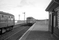 The mid afternoon Elgin-Cairnie Junction DMU waits to cross an Aberdeen-Elgin DMU at Portessie on 2nd May 1968. <br><br>[David Spaven&nbsp;02/05/1968]