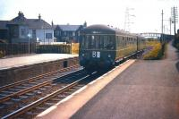 A Musselburgh - Waverley DMU arrives at Joppa station (closed 1964) on 14 June 1958.<br><br>[A Snapper (Courtesy Bruce McCartney)&nbsp;14/06/1958]