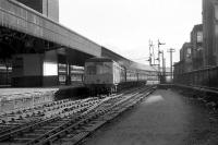 When Aberdeen's platform 6 north was blocked during the reconstruction work in 1973 [see image 20303], Inverness services departed from platform 8. Here a Swindon Cross Country set departs from 8 and takes the crossover to 9 in order to gain access to the single line to Dyce at Aberdeen North SB.<br><br>[John McIntyre&nbsp;07/02/1973]