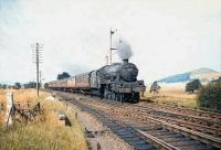 Jubilee 4-6-0 no 45617 <I>Mauritius</I> approaching Symington with a southbound WCML train on 28 August 1959.<br> <br><br>[A Snapper (Courtesy Bruce McCartney)&nbsp;28/08/1959]