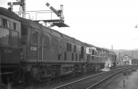 Headed by two Derby Sulzer Type 2s with a BRCW Type 2 in between, <I>The Royal Highlander</I> to Euston prepares for the off at Aviemore in the Autumn of 1967. In the late 1960s and early 1970s, it was not unusual for this 1900 departure from Inverness to be triple-headed, with 16 vehicles in the consist. A restaurant car (detached at Perth after dinner service) was marshalled directly behind the locomotives, while the rest of the train was a mix of sleepers, seating coaches, parcels vans and Motorail vehicles at the tail. The ultimate multi-purpose train!<br> <br><br>[David Spaven&nbsp;//1967]