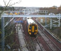 Another good vantage point bites the dust...  The 1048 ex-Waverley running under the recently installed electrification supports on the approach to Bathgate on 27 November.<br><br>[John Furnevel&nbsp;27/11/2009]