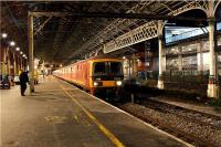 A southbound mail train waits on platform 4 at Preston station on the evening of 26 November 2009 for a path to Warrington.<br><br>[John McIntyre&nbsp;26/11/2009]