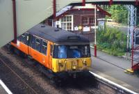 A class 303 emu calls at Whitecraigs with a Neilston-Glasgow service in 2000<br> <br><br>[David Spaven&nbsp;//2000]