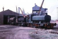 Just before closure of Millom Ironworks, Millom No.1 (AB 2333/1953) draws No.12 and No.3 out of the shed to be photographed. No.1 and No.12 (AB 929/1902) went to the Lakeside Railway soon afterwards. The development of the Barclay 0-4-0ST over many years can be seen by studying these two locos. No.3 had been built by New Lowca Engineering 250/1912 and was out of use with coupling rods removed. This loco came from Cleator Moor in 1932 but was little used as it was known to wear axleboxes unevenly, possibly due to a bent frame. Being a rare beast, efforts were made to find a buyer but in 1968 many locos in scrap yards were in full working order. There were no takers for this damaged machine and it was scrapped in 1969.<br><br>[David Hindle&nbsp;19/09/1968]