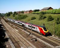 A southbound Virgin Super Voyager passes Farrington Curve Junction on the Up Fast on 22 June 2006 in bright sunshine.<br><br>[John McIntyre&nbsp;22/07/2006]