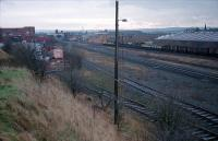 Looking south to Kilmarnock station. The two lines closest to the camera are those serving the (in 2009) closing J. Walker blending and bottling plant in Kilmarnock. The two lines run behind the camera to a reversing spur. To the right is the line from Glasgow via Barrhead, the former line from Glasgow via Dalry and CCE sidings known as <i>the Long Lyes</i>. The red brick building, distant centre, is the power signalbox with the line to Barassie behind it. To the distant left is Kilmarnock station.<br><br>[Ewan Crawford&nbsp;/01/1988]